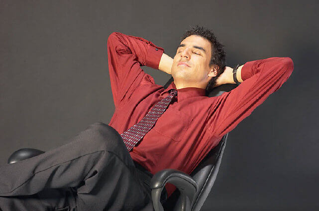 man-relaxing-in-chair-be-5